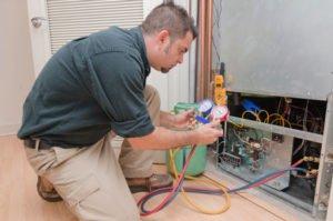 installer servicing home ac air handler